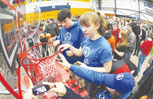 FIRST Team 501 Members at SNHU looking at the hoop for the 2012 game.